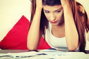 woman-stressed-out-personal-finance-and-debt